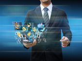 Businessman holding smartphone world technology social media — Stockfoto