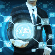 Businessman holding icon of social network — Stock Photo #55207195