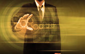 Businessperson holding gears and button touch screen — Stock Photo