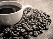 Black and white coffee on grunge wooden background — Stock Photo