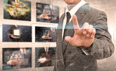 Businessman hand pushing button on a touch screen interface in t — Stock Photo