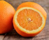 Orange fruit  on brown wooden background — Zdjęcie stockowe