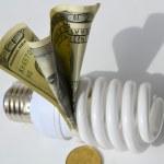 Light bulb on money background — Stock Photo #69397021