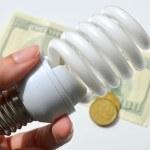 Light bulb on money background — Stock Photo #69397029