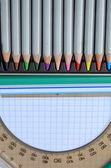 Colored pencils, pen, protractor — Stock Photo