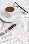 Consultation betting odds list while serving morning coffee — Stock Photo