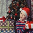 Happy child with christmas gift box. Christmastime — Stok fotoğraf #59023371