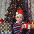 Happy boy with christmas present box — Stock Photo #59023377