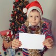 Boy holding greeting card. Christmastime — Stock Photo #59023521
