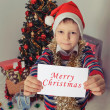 Boy holding greeting card. Christmastime — Stock Photo #59023529