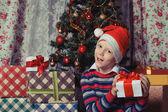 Happy child with christmas gift box. Christmastime — Stockfoto