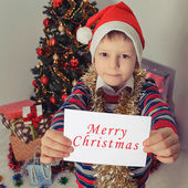 Boy holding greeting card. Christmastime — Stockfoto