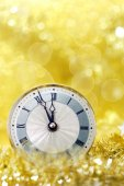 Happy New Year. Old clock on yellow abstract background — Stock Photo