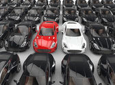 Stand out red and white cars among many black cars — Stockfoto