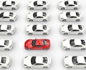 Red car among many rows of white cars — Stock Photo