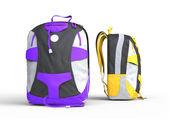 Purple and yellow backpacks — Stock Photo