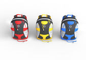 Red, yellow and blue backpacks - top view — Stock Photo