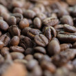 Creative composition of roasted coffee beans on a table with a nice bokeh in the background. soft focus. — Stock Photo #75203837