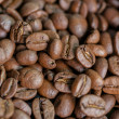 Creative composition of roasted coffee beans on a table with a nice bokeh in the background. soft focus. — Stock Photo #75203899