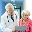 Doctor Shows Female Elderly Patient Results. — Stock Photo #61182711