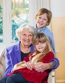 Portrait of a grandmother with her grandchildren.  — Foto de Stock