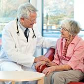 Elderly woman in consultation with her doctor. — Stock Photo