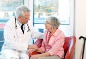 Friendly doctor reassuring an elderly woman.  — Stock Photo