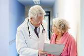 Doctor Talking to Old Woman about Good Results. — Stok fotoğraf