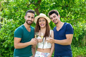 Three laughing friends celebrating with champagne. — Stock Photo