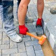 Bricklayer building up patio — Stock Photo #62672075