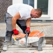 Construction worker with concrete saw — Stock Photo #62672101