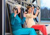 Serious senior women in gym — Stock Photo