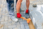 Bricklayer building up patio — Stock Photo