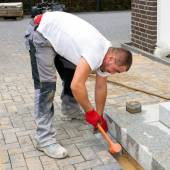 Construction worker build up pavement and terrace — Stock Photo