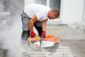 Construction worker with concrete saw — Stock Photo