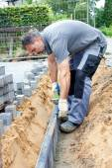Worker puts stone slabs — Stock Photo