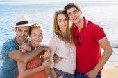 Happy friends on beach — Stock Photo