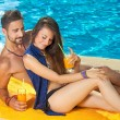 Couple relaxing at swimming pool — Stock Photo #65101699