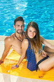 Couple relaxing at swimming pool — Stock Photo
