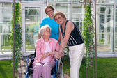 Care Takers and Patient on Wheel Chair — Stock fotografie