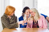 Middle Age Friends Tossing — Stock Photo