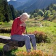 Senior Woman Sitting on Bench — Stock Photo #73634199