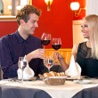Couple toasting with red wine — Stock Photo #73634353