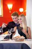 Smiling Couple in Restaurant — Stock Photo
