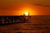 Fishermen at sunrise — Stock Photo
