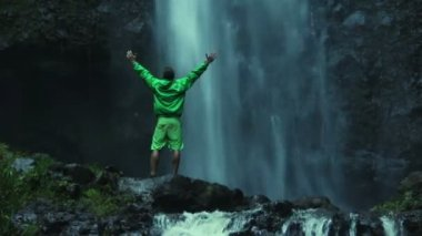 Man Doing Success Pose Outside In Front of Waterfall — Stock Video