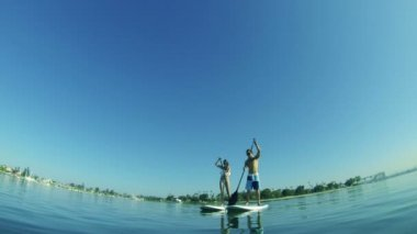 Young Happy Couple Stand Up Paddle Surfing In Ocean — Stock Video
