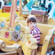 Pretty smiling little girl ride on carousel pirate ship in summe — Stock Photo #60126353