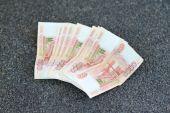 Russian money on grey asphalt. 5000 rubles banknotes closeup  — Stock Photo