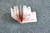 Many russian money on grey asphalt. 5000 rubles banknotes closeu — Stock Photo